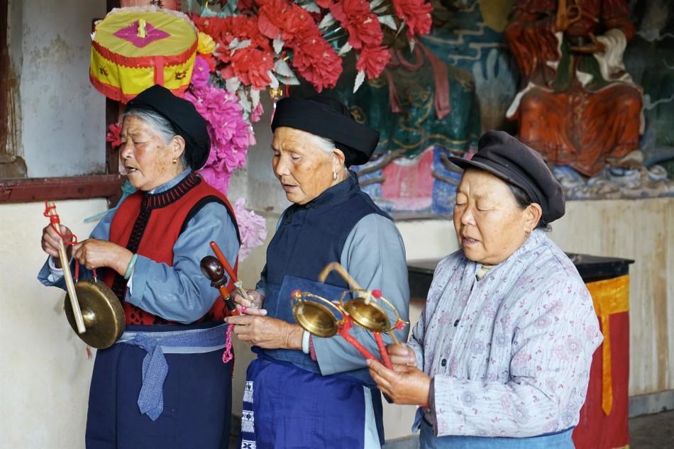 Elder women chanting - Pear Orchard Temple - Shaxi Yunnan China