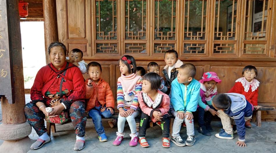 Grandma and village children - Pear Orchard Temple - Shaxi Yunnan China
