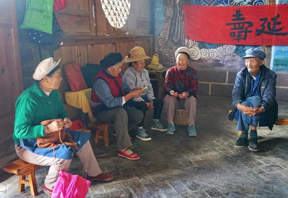 Shaxi Elders gather at Pear Orchard Temple - Shaxi Yunnan China